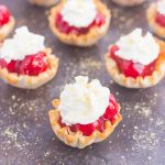 These Cherry Pie Bites are simple to make and bursting with the classic pie flavor. With just two ingredients and no oven required, you can have this mini treat ready to go for your parties or get-togethers. Top these bites with a dollop of whipped cream and crushed graham crackers and your easy dessert is ready to impress!