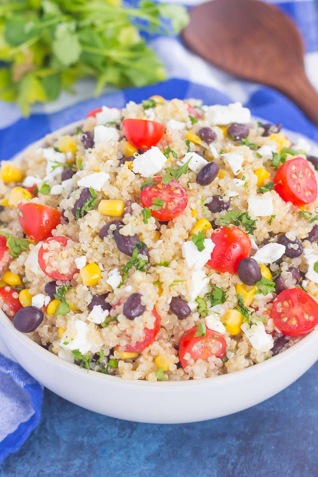 This Corn and Black Bean Quinoa Salad is hearty, on the healthier side, and perfect for a light meal. Loaded with flavor and ready in less than 30 minutes, this simple salad is perfect for lunch or dinner #quinoa #quinoasalad #quinoasaladrecipe #quinoabowl #cornsalad #blackbeansalad #healthysalad #salad #healthylunch