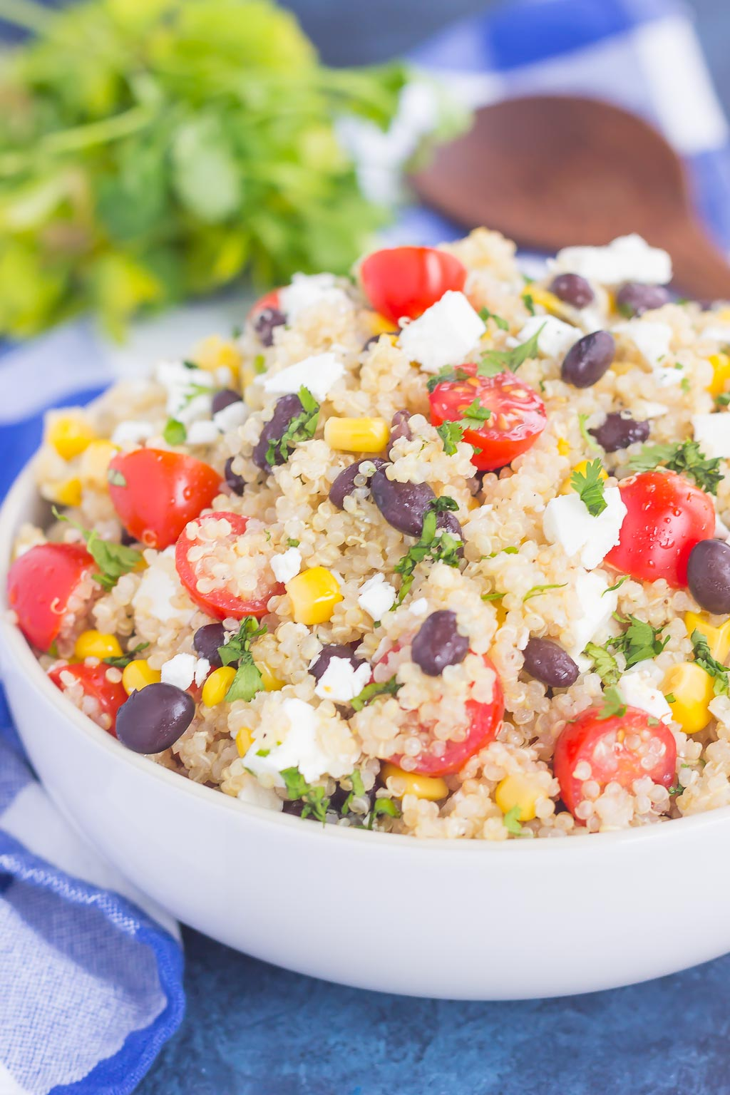 This Corn and Black Bean Quinoa Salad is hearty, on the healthier side, and perfect for a light meal. Quinoa is tossed with black beans, fresh corn, cilantro and tomatoes, and then tossed in a light white balsamic dressing. Loaded with flavor and ready in less than 30 minutes, this simple salad is perfect for lunch or dinner!