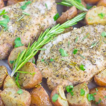 This Sheet Pan Rosemary Herb Pork Chops and Roasted Potatoes is a deliciously easy meal for busy nights. Made entirely on one pan and seasoned to perfection with fresh rosemary and herbs, this simple dish is sure to be a dinnertime favorite all year long!