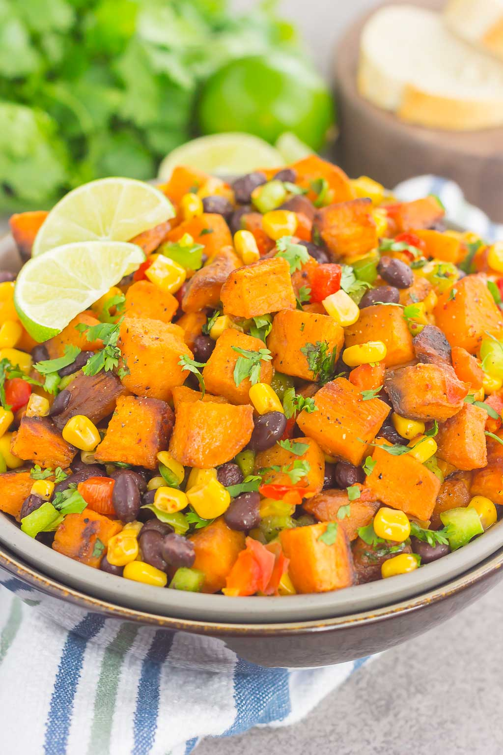 sweet potato potato salad garnished with cilantro and lime wedges