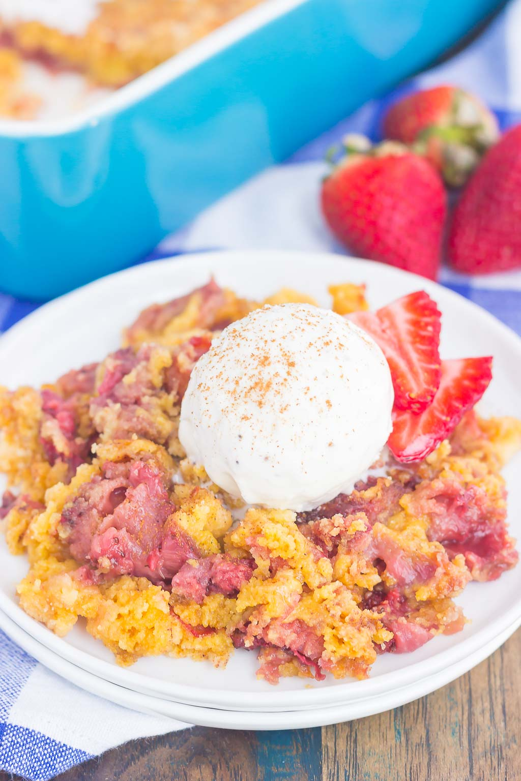 This Strawberry Cinnamon Dump Cake is a deliciously easy dessert that's loaded with flavor. With just four ingredients and hardly any prep time, this simple cake tastes like your favorite cobbler, but without all of the work. Filled with fresh strawberries, a hint of cinnamon and topped with a buttery, crumbly topping, this dessert is sure to be a winner all year long!