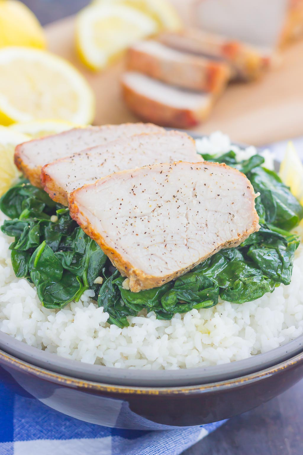 This Grilled Garlic Herb Pork Bowl is an easy meal that's loaded with flavor. Marinated pork loin filet is prepared on the grill and then tossed with some white rice and sautéed spinach. Simple to make a perfect for busy weeknights, this hearty dinner is sure to be a favorite all year long!