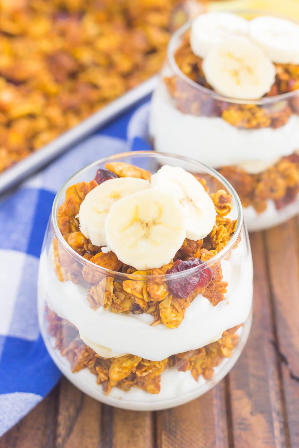 yogurt, pumpkin granola, banana slices layered in a glass