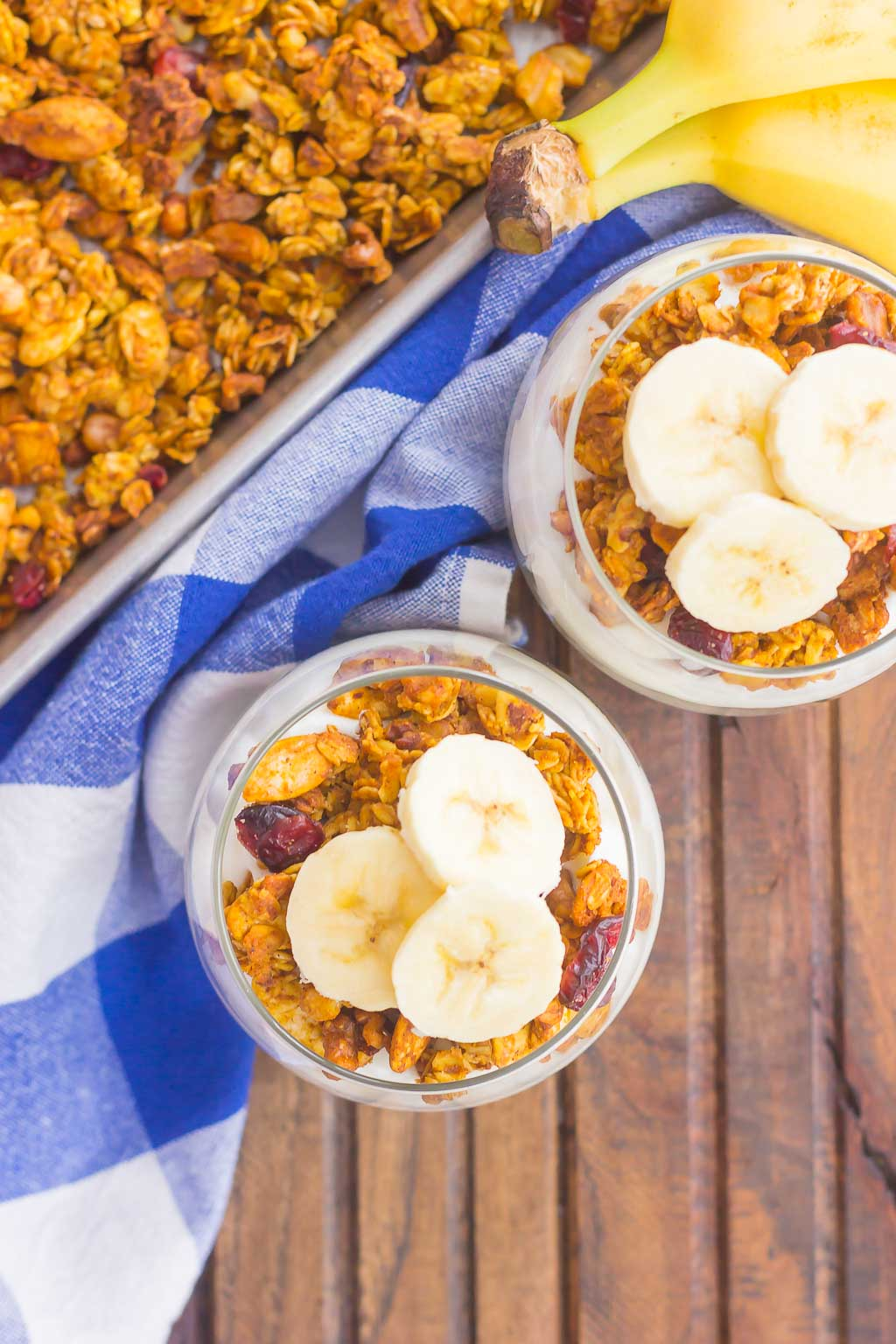 Pumpkin Banana Yogurt Parfait makes a deliciously simple breakfast or snack. Packedwith vanilla yogurt, pumpkin spice granola and fresh banana slices, this healthier dish is easy to make and perfect for fall!