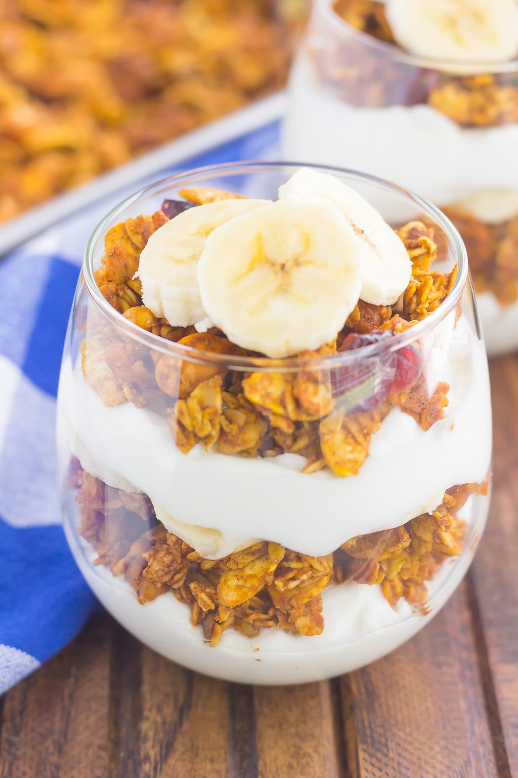 Pumpkin Banana Yogurt Parfait makes a deliciously simple breakfast or snack. Packed with vanilla yogurt, pumpkin spice granola and fresh banana slices, this healthier dish is easy to make and perfect for fall!