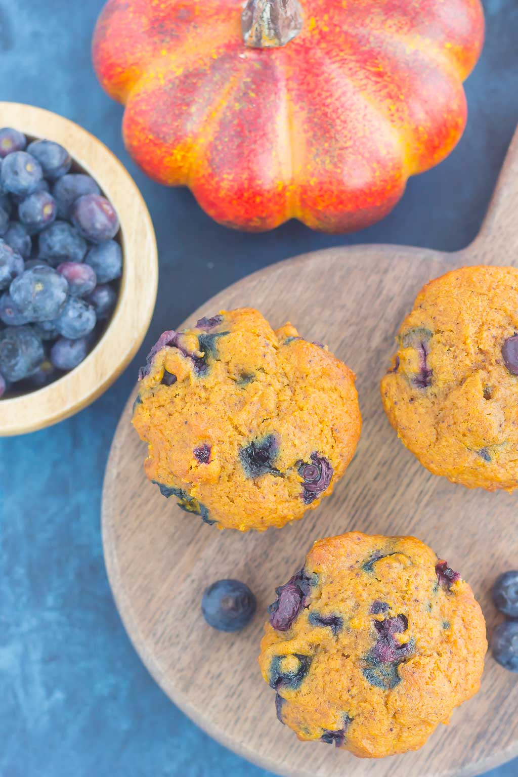 These Pumpkin Blueberry Muffins are soft, moist and bursting with cozy fall flavors. Packed with sweet pumpkin and juicy blueberries, this easy treat makes the perfect fall breakfast or snack! #pumpkinmuffins #pumpkinblueberrymuffins #muffins #blueberrymuffins #pumpkinbreakfast #pumpkindessert #falldessert #dessert #breakfast