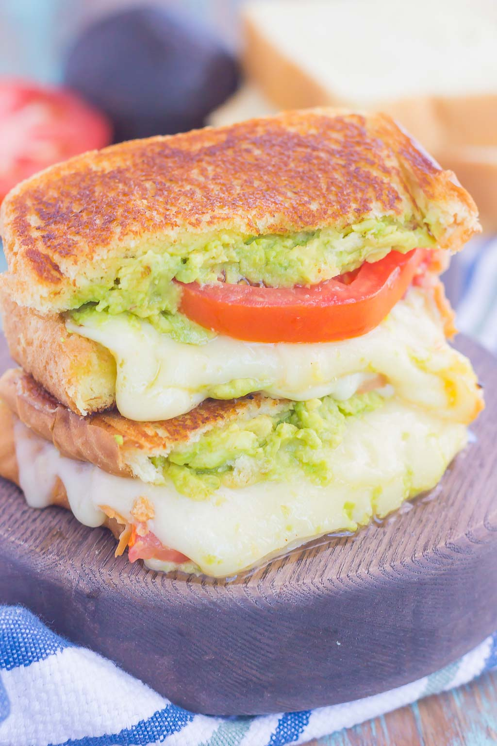 Tomato, Avocado and Mozzarella Grilled Cheese is filled with fresh tomato slices, smashed avocado and creamy mozzarella cheese. Grilled until golden on the outside and melty on the inside, this sandwich is perfect to pair with soup for an easy lunch or dinner!