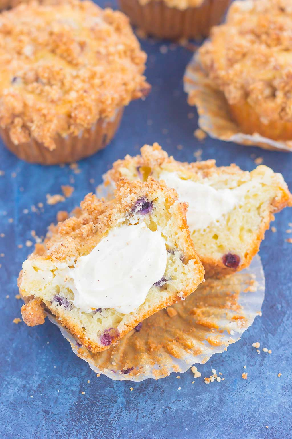 These Blueberry Cheesecake Muffins make a delicious breakfast or easy dessert. Filled with tangy blueberries, a sweet cheesecake filling and topped with a buttery streusel, these muffins will quickly become everyone's favorite treat!