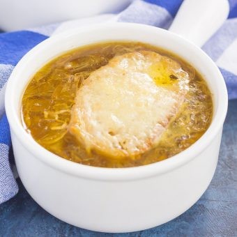 French Onion Soup is loaded with caramelized onions, a rich and savory broth, and just the right amount of spices. It takes just minutes to prepare, letting your stove do the rest of the work. Topped with a piece of French bread and smothered with melted cheese, this is the ultimate soup to warm you up on a chilly day!