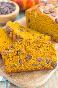 This Pumpkin Peanut Butter Spice Bread is filled with a warm pumpkin flavor, dark chocolate chips, and creamy peanut butter. Easy to make and filled with an irresistible combination, this spiced bread will become your favorite breakfast or dessert of the season!