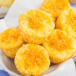 These Cheesy Cornbread Muffins are loaded with flavor and easy to make. Filled with cheddar cheese, zesty spices and baked until golden, these muffins are perfect to serve as a simple side dish or snack!