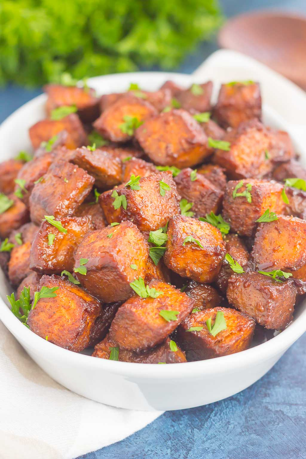 These Roasted Cinnamon Brown Sugar Sweet Potatoes make a deliciously simple side dish. Sweet cinnamon and brown sugar are tossed with sweet potatoes and roasted until crispy on the outside and tender on the inside! #sweetpotatoes #roastedsweetpotatoes #sweetpotatorecipe #cinnamonsweetpotatoes #brownsugarsweetpotatoes #roastedpotatoes #sidedish