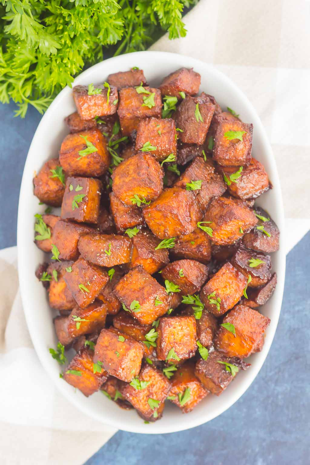 These Roasted Cinnamon Brown Sugar Sweet Potatoes make a deliciously simple side dish. Sweet cinnamon and brown sugar are tossed with sweet potatoes and roasted until crispy on the outside and tender on the inside. Loaded with flavor and easy to make, this dish is perfect for sweet potato lovers everywhere!