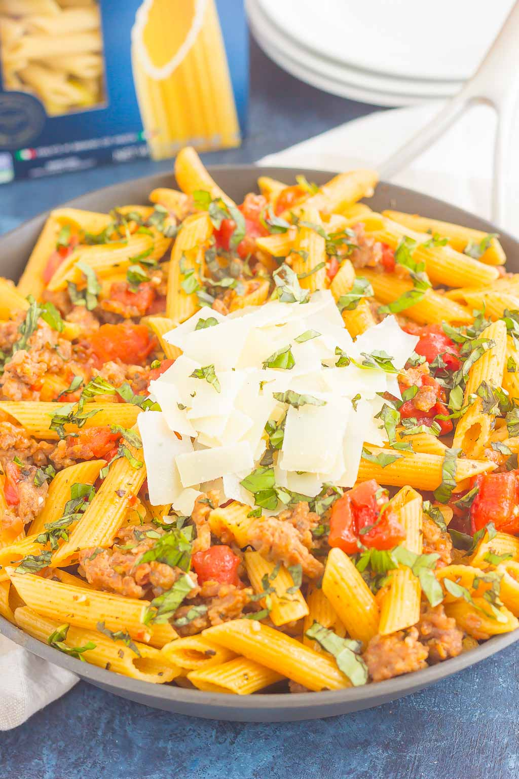 tomato basil pasta with italian sausage in large bowl