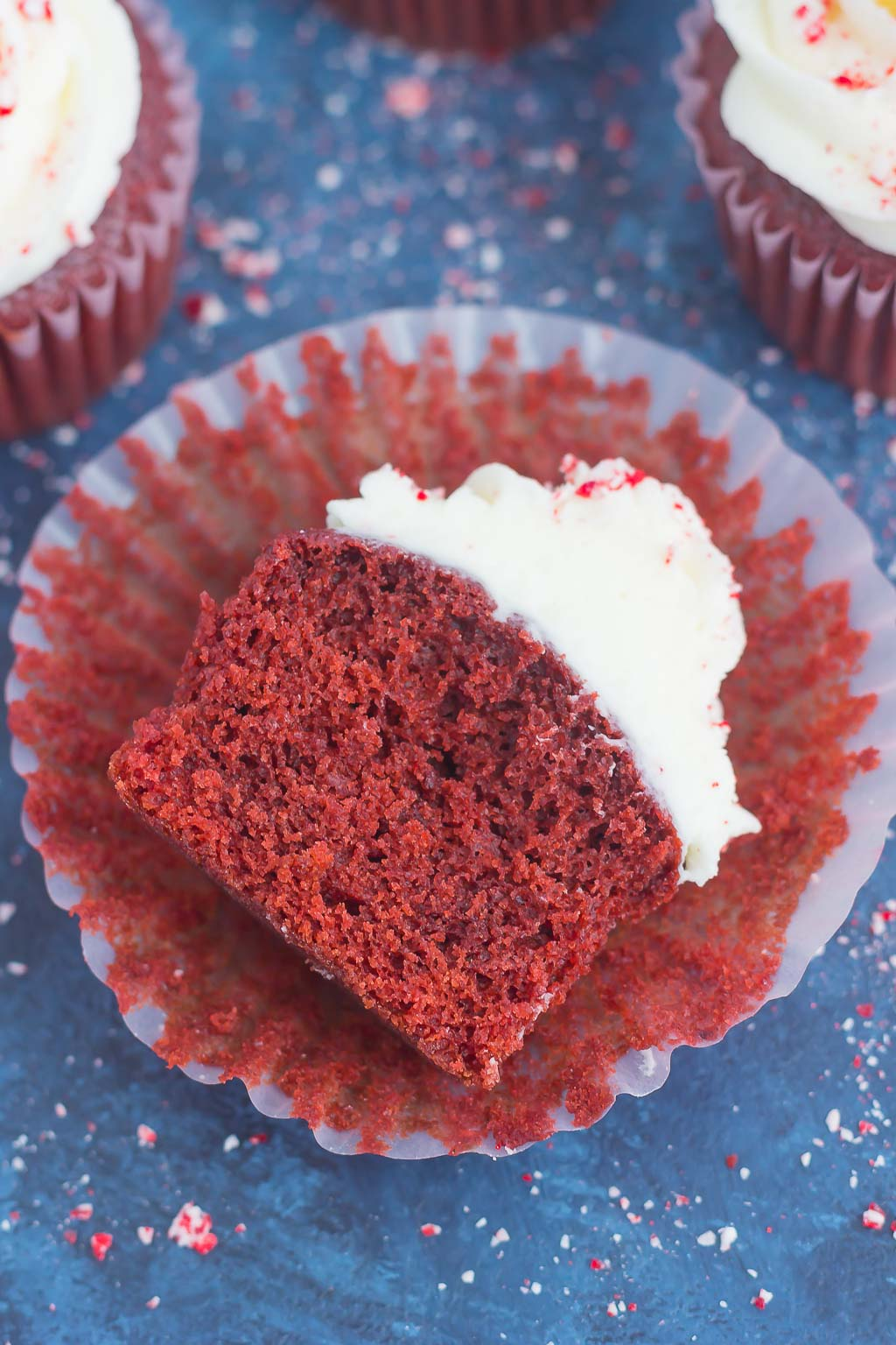 These Peppermint Red Velvet Cupcakes are light, fluffy, and bursting with sweet chocolate and hint of peppermint. Simple to make and topped with a swirl of peppermint frosting, these festive cupcakes will be the hit of the holiday season!