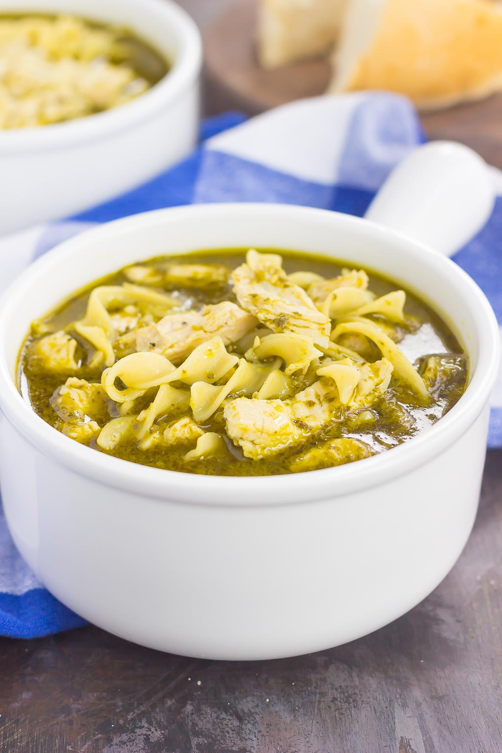 This Pesto Chicken Noodle Soup is made in one pot and ready in just 30 minutes! Filled with rotisserie chicken, tender noodles and enveloped in a simple pesto chicken broth, this easy dish is loaded with flavor and perfect for just about any time!