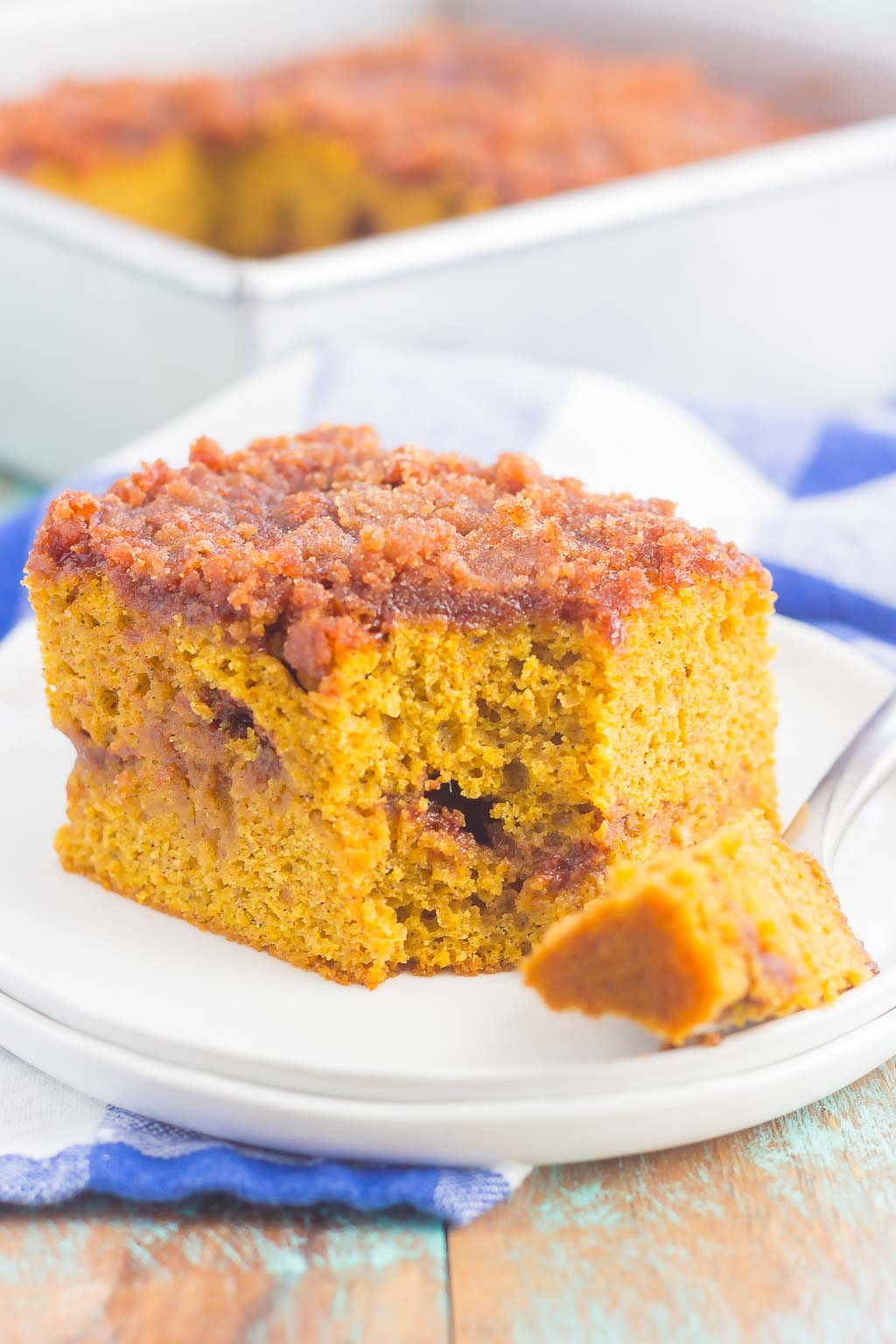 This Gluten Free Pumpkin Cinnamon Crumb Cake requires just a few ingredients and is ready in no time. Fluffy pumpkin cake is swirled with a sweet cinnamon streusel and then baked until golden. This easy cake is perfect to serve at all of your holiday gatherings! #cake #pumpkincake #crumbcake #glutenfree #glutenfreecake #glutenfreepumpkincake #pumpkincrumbcake #pumpkinrecipes #pumpkindessert #dessert