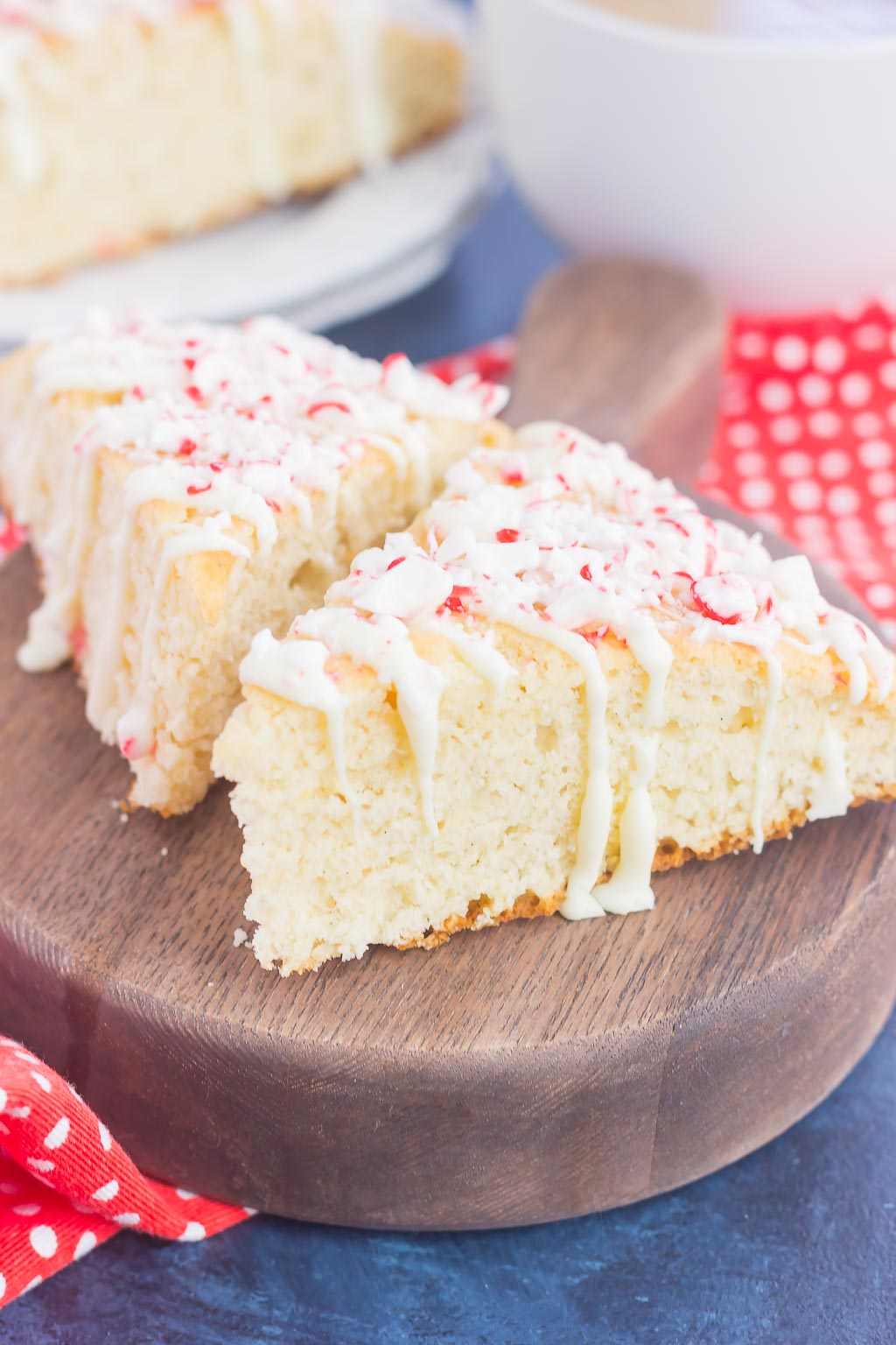 These White Chocolate Peppermint Scones are light, fluffy and bursting with flavor. Filled with hints of peppermint and topped with a white chocolate and peppermint glaze, these soft scones make the best holiday breakfast or dessert!