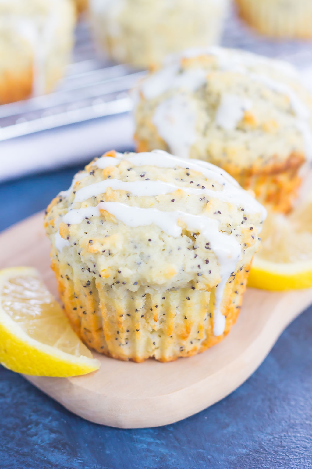 These Lemon Poppy Seed Muffins are soft, fluffy and bursting with flavor. Drizzled with an easy cream cheese glaze, these muffins are perfect for a simple breakfast or dessert!