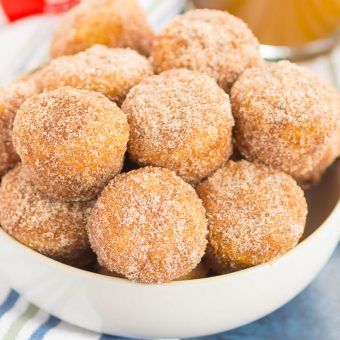 These Baked Cinnamon Sugar Donut Holes are soft, fluffy, and easy to make. Sweet cinnamon and sugar gives this simple baked donut the perfect touch of flavor. Perfect to serve for breakfast or dessert!