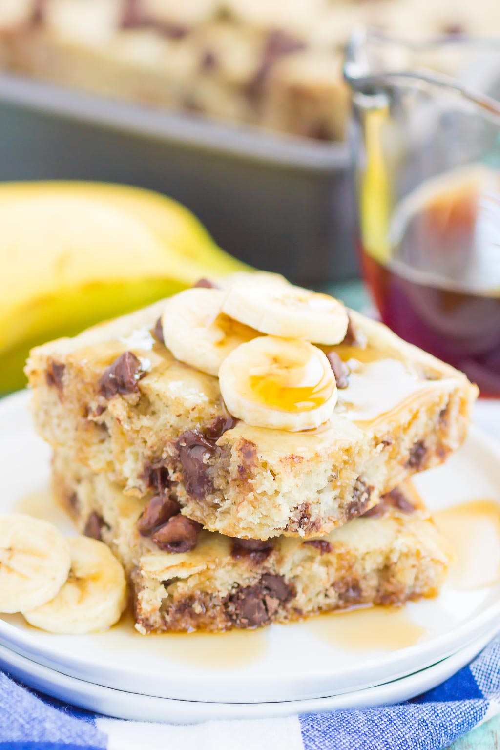 two sheet pan banana chocolate chip pancake squares a white plate