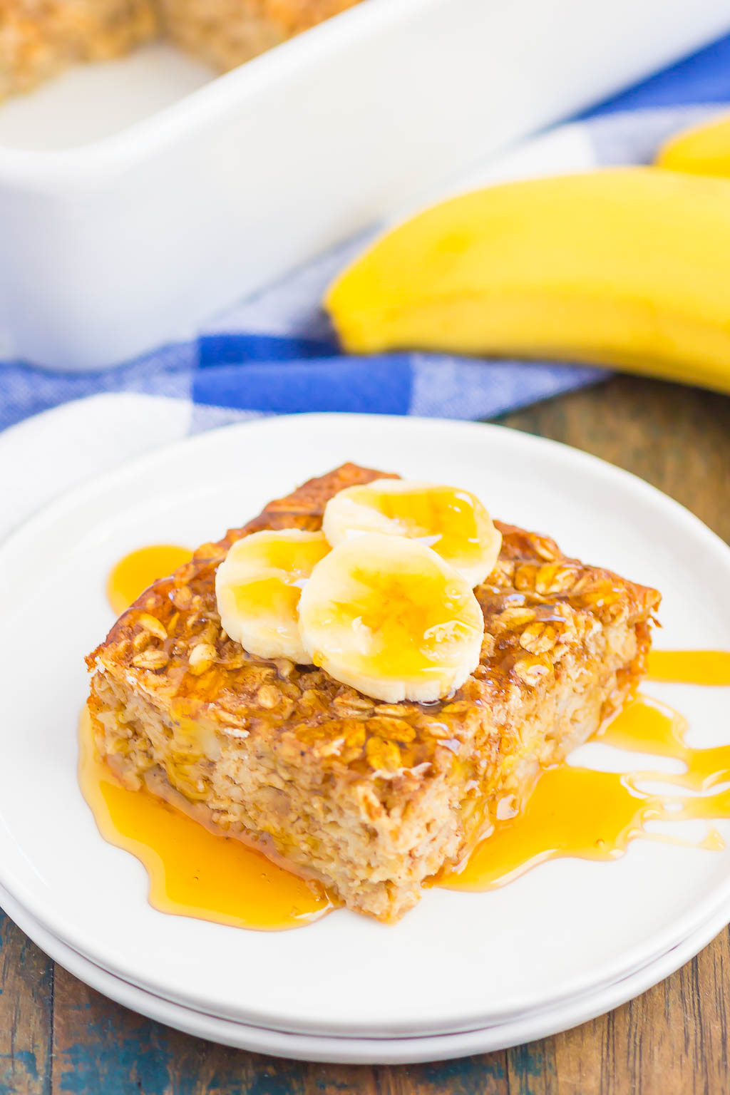 This Baked Banana Bread Oatmeal is filled with hearty oats, sweet bananas, and just the right amount of spices. It's the perfect dish to make on the weekend and slice up for your weekday breakfast! #bakedoatmeal #bananaoatmeal #bakedbananaoatmeal