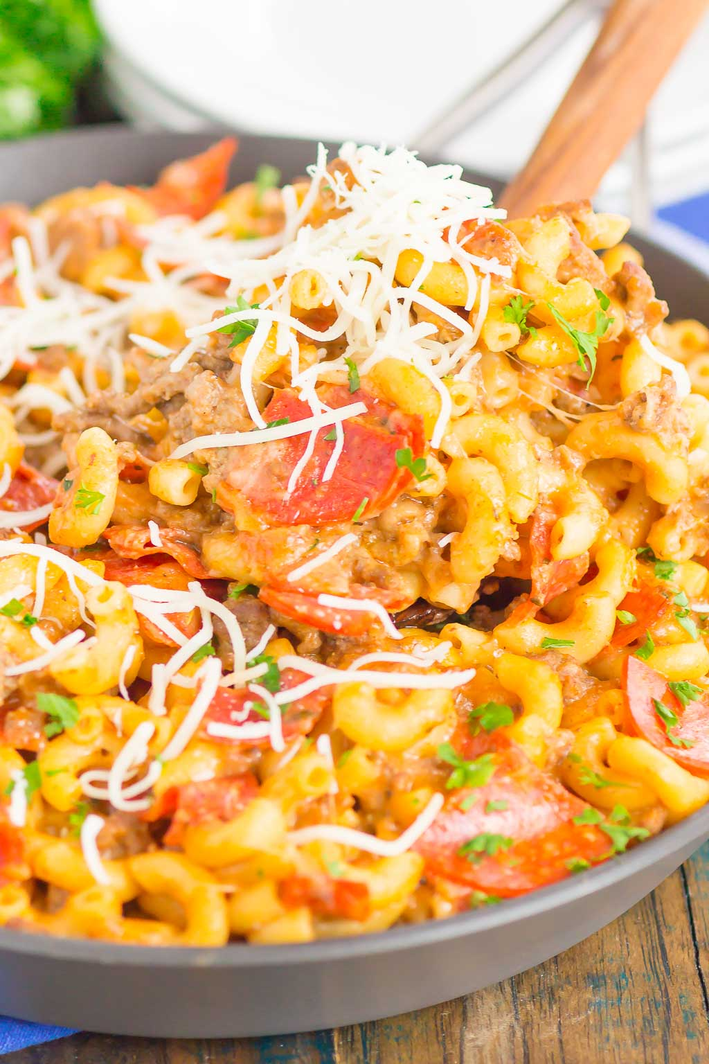 This Pepperoni Pizza Hamburger Helper is a simple, one pan dish that's ready in just 30 minutes. Better than the boxed kind, this cheesy pasta combines the classic flavors of pepperoni pizza that'll be a hit at the dinner table for years to come! #hamburgerhelper #pizzahamburgerhelper #pizzacasserole #pasta #pizzapasta #onepot