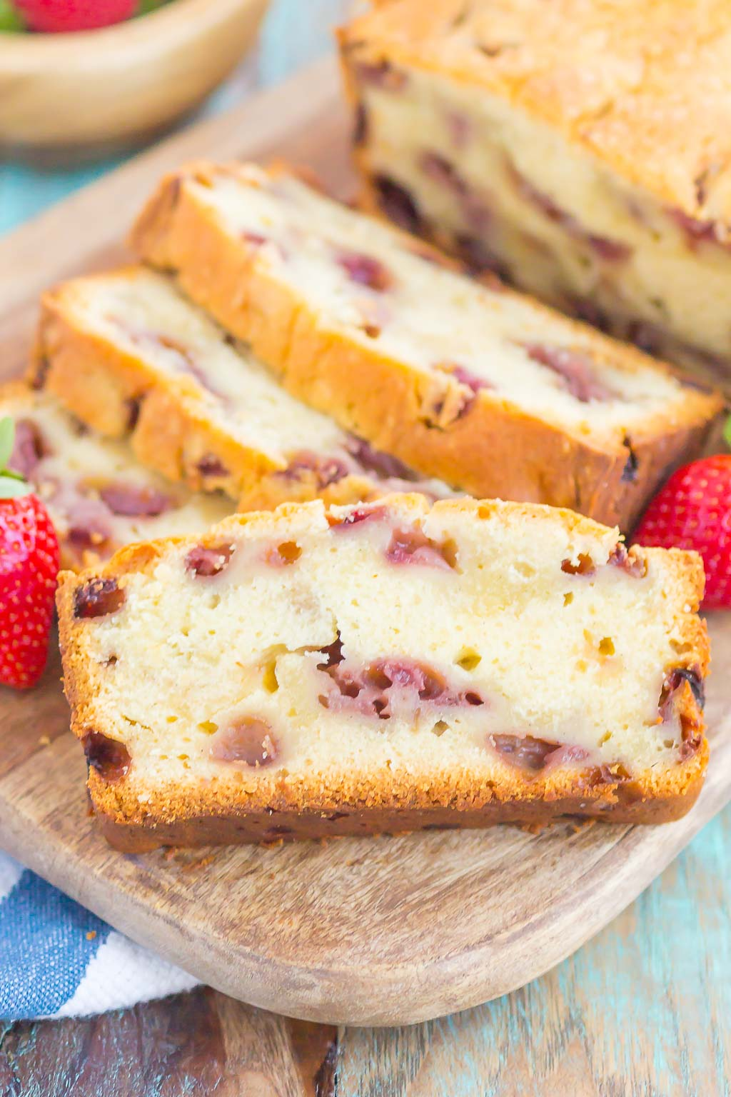 Strawberry Pound Cake is a simple, one bowl recipe that's bursting with flavor. Fresh strawberries are sprinkled throughout this soft and dense pound cake, resulting in the most delicious taste. Perfect to serve alongside your morning coffee or as a tasty dessert! #poundcake #strawberrypoundcake