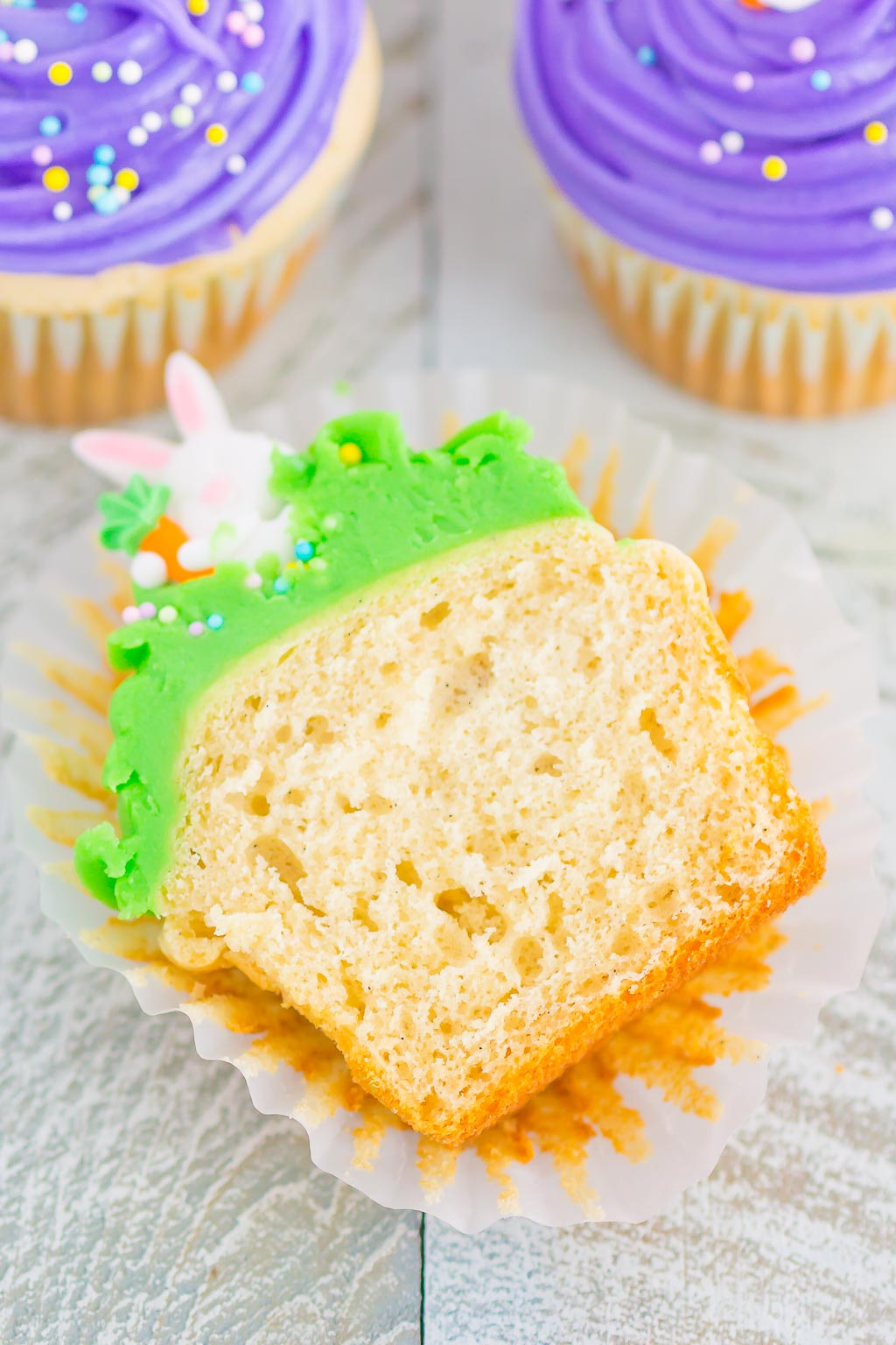 Easter Bunny Cupcakes are an easy and festive dessert to make for spring. A soft and moist yellow cupcake batter is baked until golden and then topped with a simple frosting, pastel sprinkles and a candy bunny. Fun, fast, and flavorful, these adorable cupcakes are perfect for Easter!