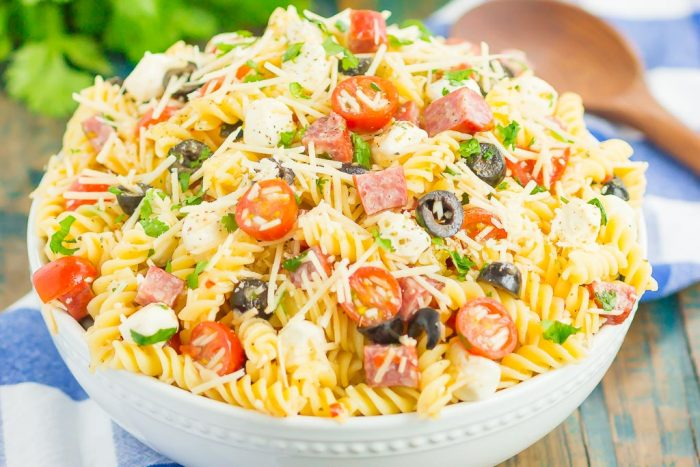 Easy Italian Pasta Salad is fast, fresh, and loaded with flavor. This zesty salad is packed with classic favorites, like salami, mozzarella pearls, black olives, cherry tomatoes and then tossed in a simple Italian dressing. Easy to make and ready in less than 30 minutes, this salad is perfect to serve for those summer parties and get-togethers!
