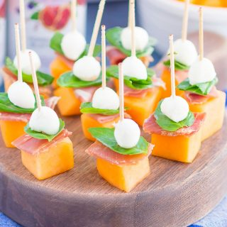 Prosciutto Melon Bites are a simple, sweet and salty appetizer that's perfect for any time. Salty prosciutto and sweet melon are paired with fresh mozzarella and basil to create a match made in food heaven. Easy to make and ready in no time, everyone will love these tasty bites!