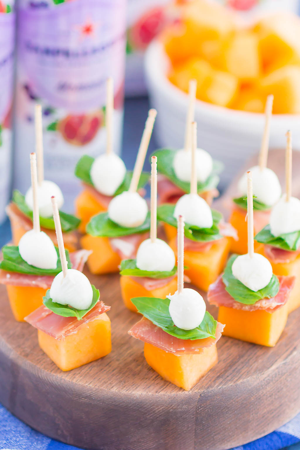 Prosciutto Melon Bites are a simple, sweet and salty appetizer that's perfect for any time. Salty prosciutto and sweet melon are paired with fresh mozzarella and basil to create a match made in food heaven. Easy to make and ready in no time, everyone will love these tasty bites! #prosciuttobites #melonbites #prosciuttomelon #prosciuttoappetizer