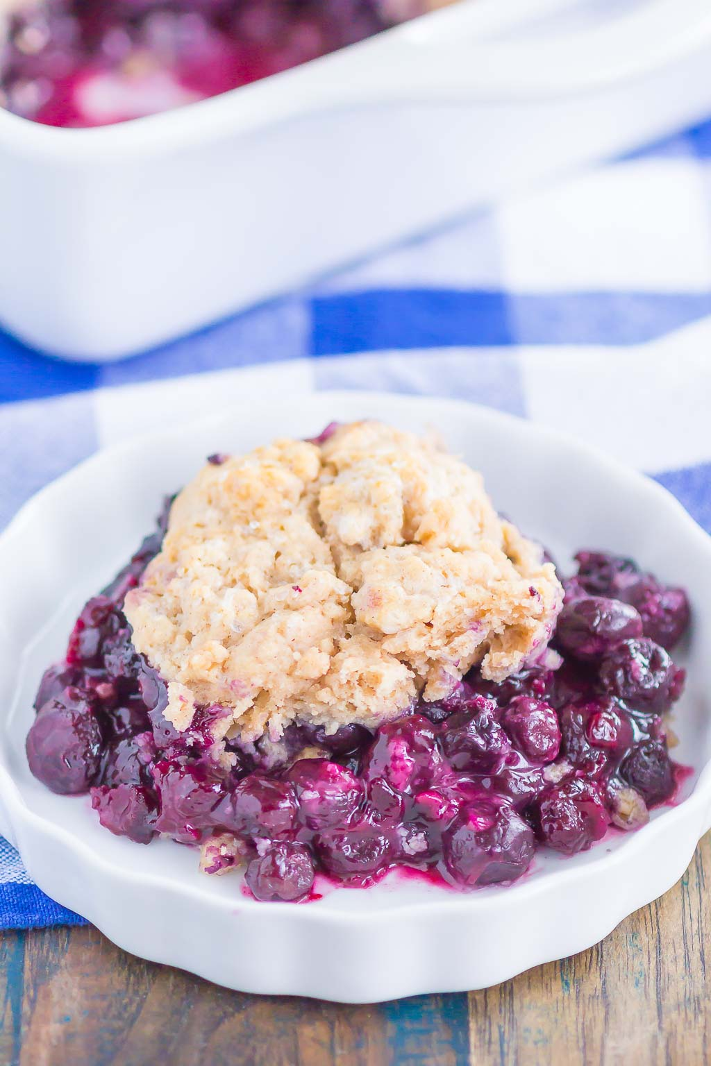 Easy Blueberry Cobbler is a simple dessert that's ready in no time. Tangy blueberries are tossed with cozy spices and then sprinkled with a buttery, cinnamon sugar cake-like topping. Easy to make and loaded with flavor, this cozy cobbler is perfect to enjoy all year long! #cobbler #blueberrycobbler #blueberrydessert