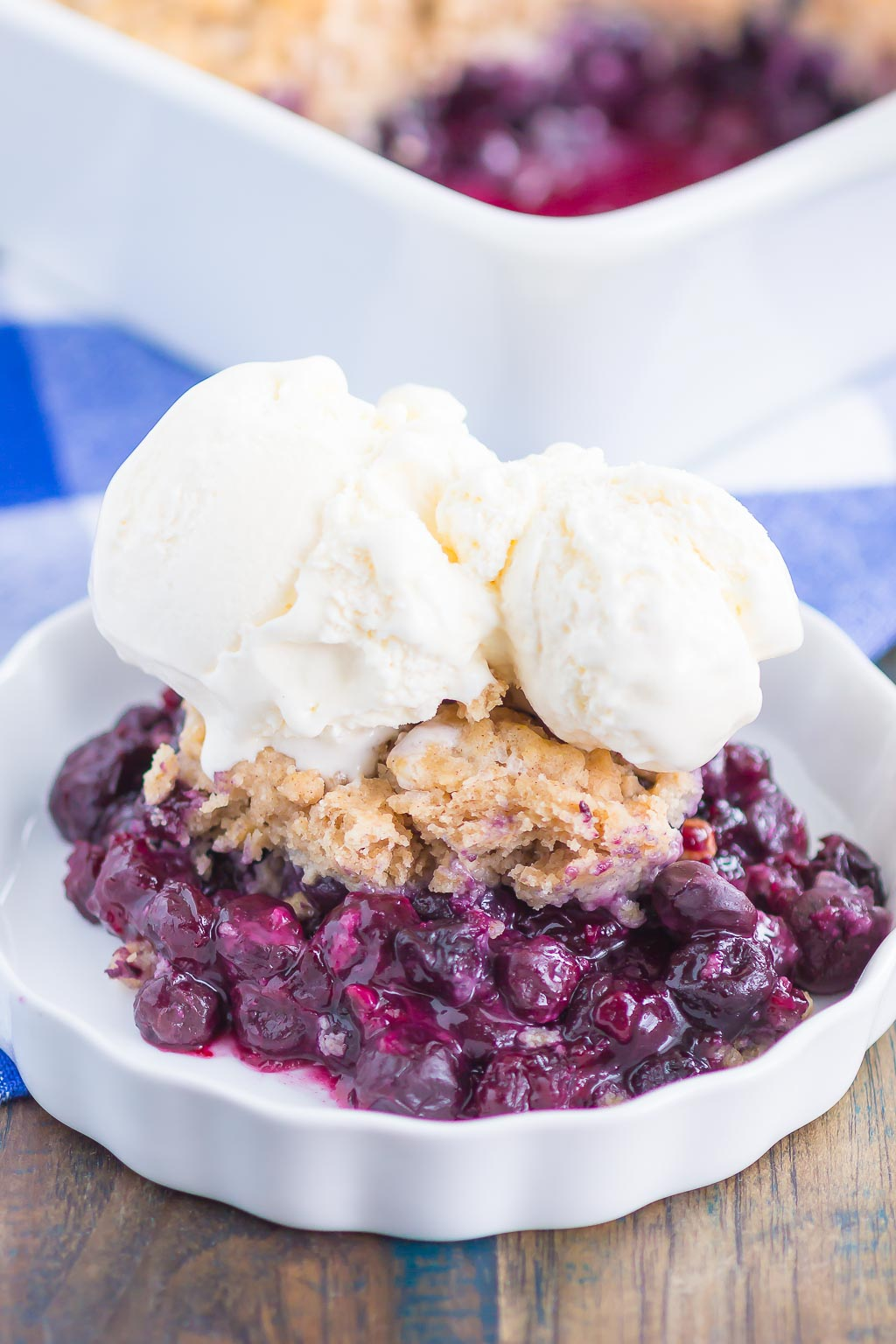 Easy Blueberry Cobbler is simple dessert that's ready in no time. Tangy blueberries are tossed with cozy spices and then sprinkled with a buttery, cinnamon sugar cake-like topping. Easy to make and loaded with flavor, this cozy cobbler is perfect to enjoy all year long!