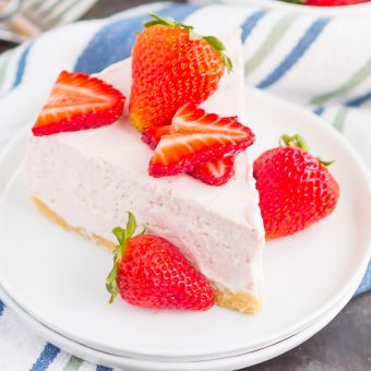 No Bake Strawberry Cheesecake is a simple dessert that's perfect for summer. A golden cookie crust is topped with a creamy strawberry cheesecake filling and then chilled to perfection. Easy to make and with no oven required, this decadent cake makes the most delicious treat!