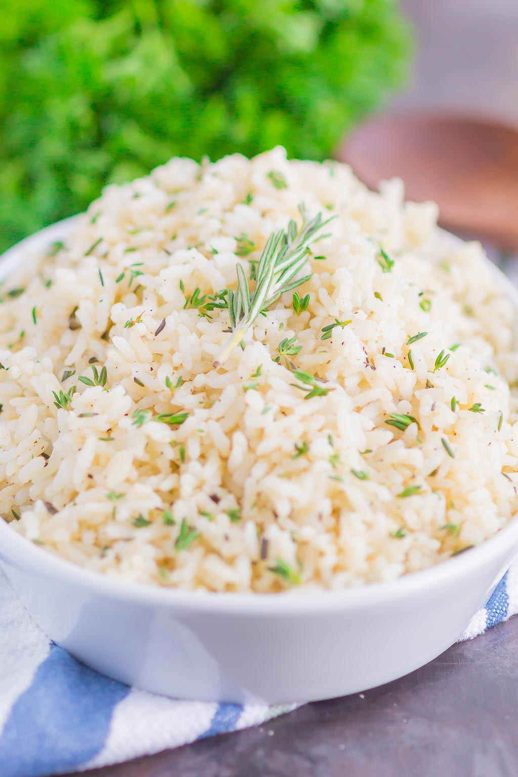 Garlic Herb Rice is a simple side dish that's ready in just 20 minutes. A mixture of fresh herbs, garlic and butter make this easy dish loaded with flavor and perfect to accompany any meal!