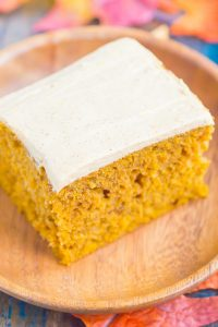 a slice of pumpkin cake with cream cheese frosting