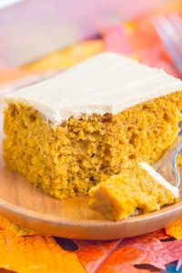 a slice of pumpkin spice cake with a bite on a fork