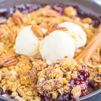 Cherry Pecan Crisp is an irresistibly easy summer dessert. Sweet cherries and a buttery, crunchy pecan streusel makes the best fruit dish that's ready in no time! #crisp #cherrycrisp #pecans #pecancrisp #fruitdessert #summerdessert #summercrisp #pecandessert #dessert #recipe