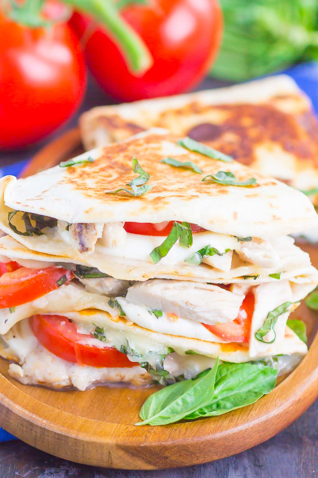 Chicken Caprese Quesadillas are an easy meal that comes together in minutes. With shredded chicken, fresh mozzarella, tomatoes and basil, this dish is kid-friendly and perfect for just about any time! #quesadillas #chicken #chickenquesadilla #caprese #capresequesadilla #chickendinner #dinner #recipe