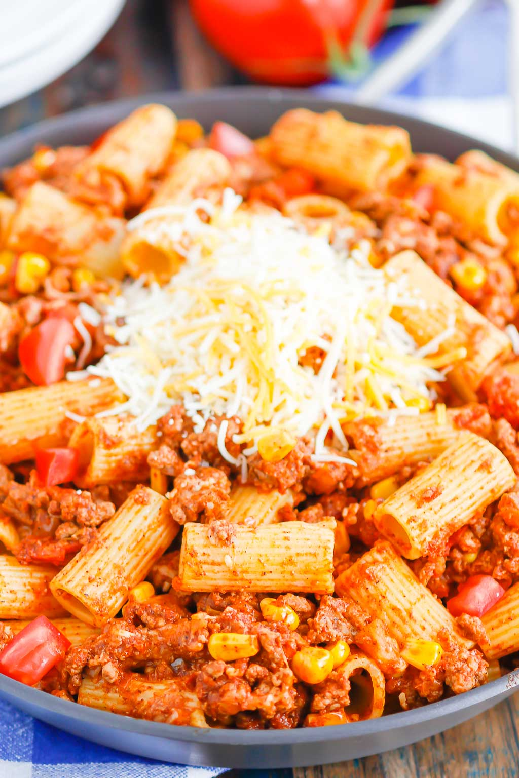 chili pasta garnished with cheese in a large skillet