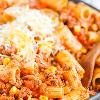 There is no better comfort food than this Chili with Pasta skillet meal. A comforting combination of ground beef, tomatoes, corn, and pasta come together with the perfect homemade chili seasoning to create an all in one meal you'll love! #chili #chilipasta #chilipastaskillet #skilletdinner #pasta #easydinner #dinner #comfortfood