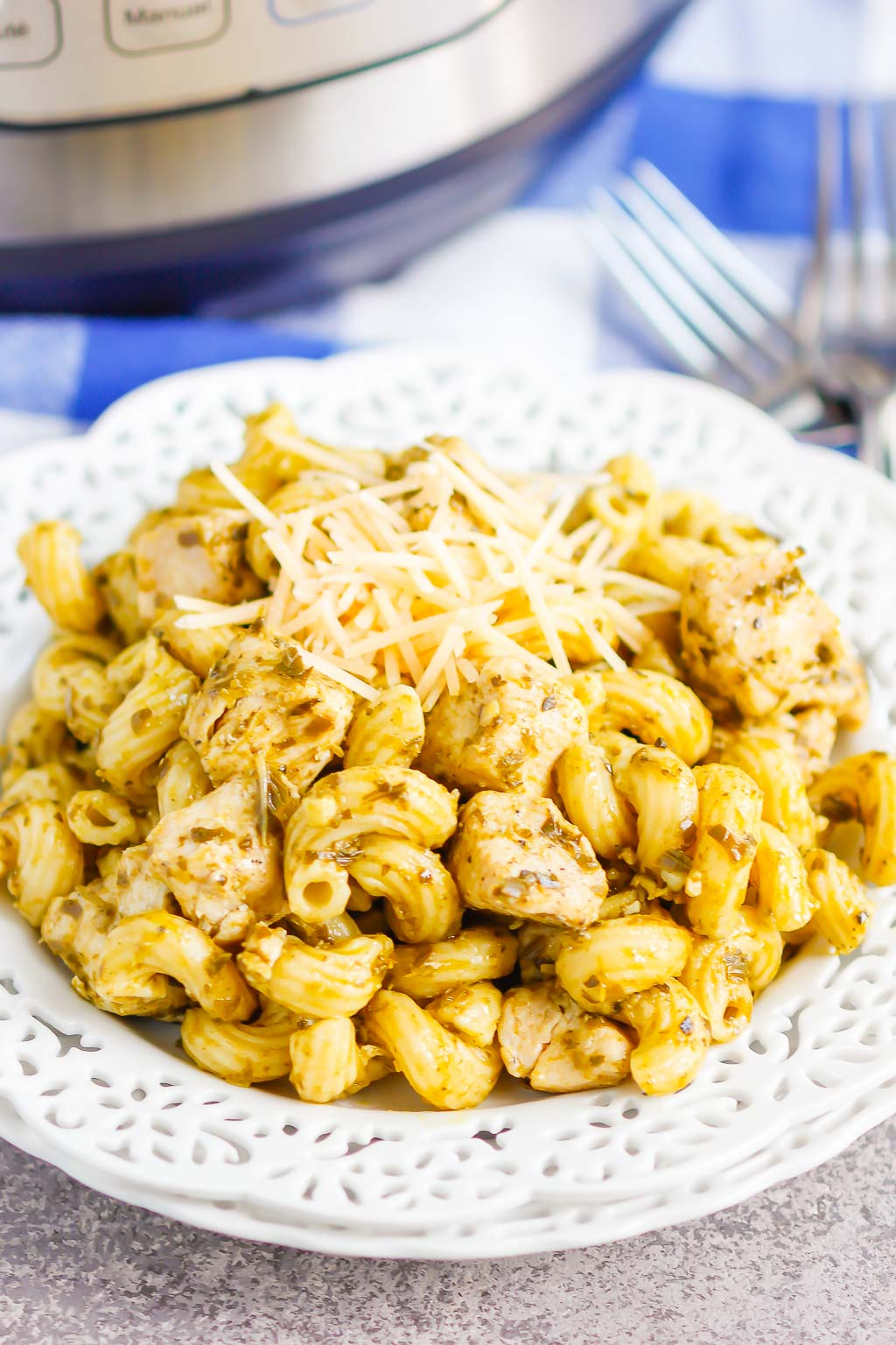 Instant Pot Pesto Chicken with Pasta is a delicious weeknight meal that combines the bright basil and garlic flavor of pesto with easy to cook chicken and pasta. The entire meal made in your Instant Pot in a little more than 30 minutes makes this a perfect weeknight recipe! #chicken #pestochicken #pesto #pestochickenpasta #pasta #instantpot #instantpotchicken #instantpotpasta #weeknightdinner #easydinner #dinner