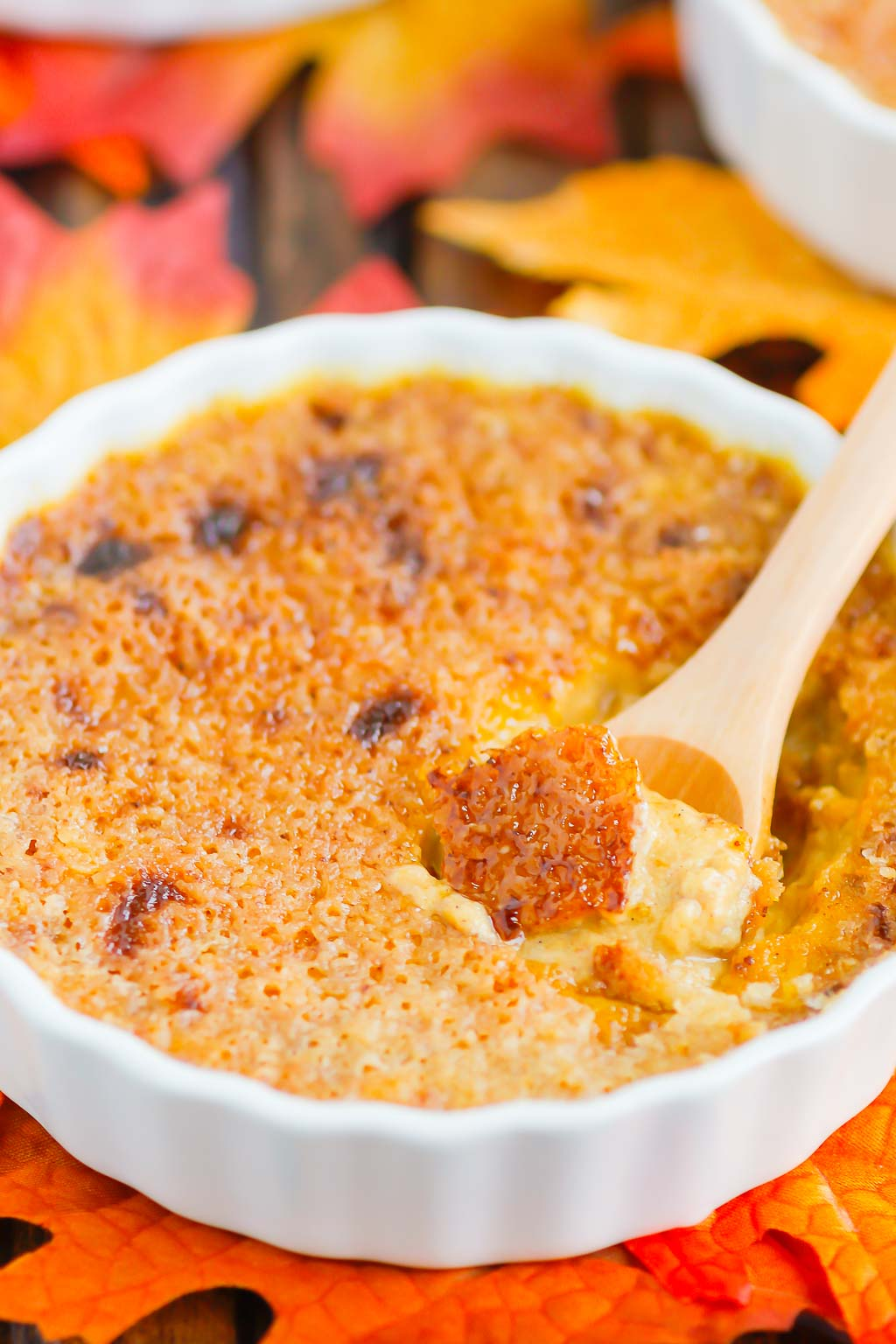 Pumpkin Crème Brûlée features a smooth and creamy custard that's studded with hints of pumpkin and the most delicious caramelized topping. Easy to make, this decadent dessert captures the flavors of fall and is sure to impress everyone! #cremebrulee #pumpkin #pumpkincremebrulee #cremebruleerecipe #falldessert #pumpkindessert #fancydessert