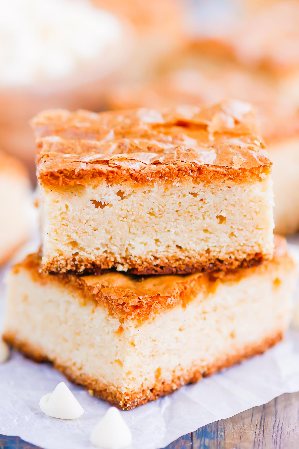 This White Chocolate Blondies Recipe combines the elegance of white chocolate with rich vanilla to bring you a delightfully sweet treat that is ready for the oven in minutes and baked in just half an hour. Serve this recipe with a hot cup of coffee for the perfect treat on a cold day! #blondies #whitechocolate #whitechocolateblondies #blondierecipe #whitechocolatedessert #dessert #easydessert