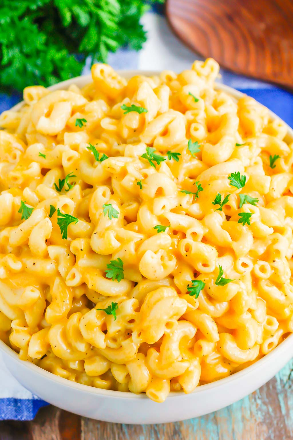 creamy instant pot mac and cheese in white serving bowl
