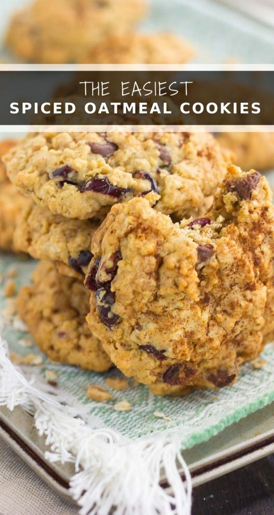These Spiced Oatmeal Cookies are packed with hearty oats, warm spices, dried cranberries, chocolate chips, and toffee bits. Soft, chewy, and bursting with fall flavors, these cookies are perfect to enjoy all year long! #cookies #oatmealcookies #cookierecipe #oatmealcookierecipe #fallcookie #falldessert #recipe