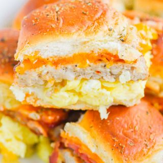 Breakfast Sliders are an easy, make-ahead dish that's filled with your favorite ingredients. Perfect to serve for a crowd or for when you need breakfast on-the-go! #sliders #breakfastsliders #breakfastsandwich #easybreakfast #makeaheadbreakfast #mealprep #breakfast