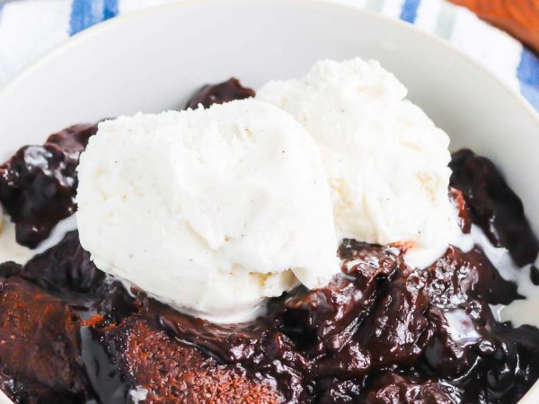 Chocolate Cobbler is a deliciously decadent dessert that's ready in no time. With a brownie like topping and a rich, fudgy sauce on the bottom, this dish tastes like molten lava cake, but in cobbler form! #cobbler #chocolate #chocolatecobbler #chocolatedessert #lavacake #dessert